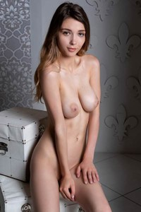 Top class hottie Mila Azul seductively strips her red lingerie to show us her amazing boobs