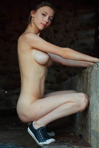 Mesmerizing brunette seductively poses naked showing off her perfectly shaped body