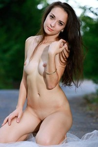 Fabulous brunette Chanel C sensually poses outdoors on the white lace