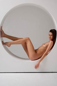 Cute and adorable girl shows off her naked body in many different flexible poses