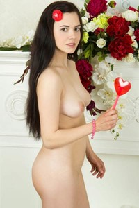 Black haired girl Lera seductively takes off her clothes and gently poses naked for you