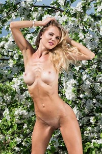 Slender sexy and tempting blonde Mila N exposing her naked body outdoors in nature