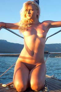 Foxy blonde doll seductively poses on the boat showing off her sexy body
