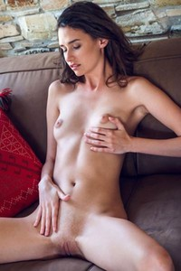 Sexy skinny babe teases her small tits and shaved pussy as she watches tv