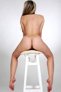 Brunette doll is changing positions on bar chair looking so adorable showing us all she got