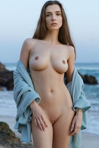 All natural brunette is already naked and she is all about to show us her big natural boobs