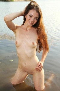 Angelic skinny babe Victoria F poses naked on the lakeshore presenting her petite pale body