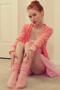 Ginger lady Dolly Little gives us nice view on her slender body wearing pinky clothes