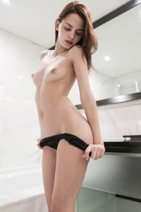 Bombastic brunette Ariel gets undressed nicely to give you nice view on her slender body