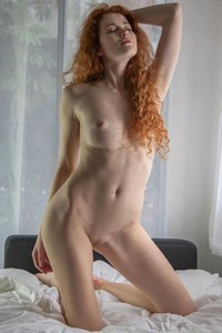 Curly haired ginger hottie seductively poses naked after slow undressing
