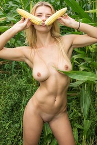 Playful blondie Yelena poses naked in the cornfield showing off her luscious body