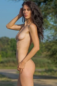 Exotic dark haired beauty Yara B poses completely naked in nature