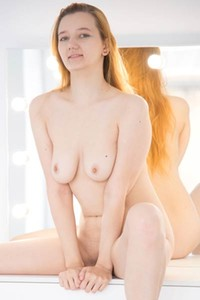 Redhead hottie with amazing pale body seductively poses naked by the mirror