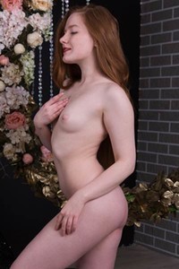 Stunning redhead babe Anicka takes off her black lace dress to show us her pale body