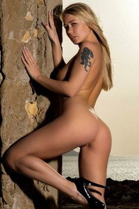Top class blonde with astonishing curves Darina slips out of her bodysuit only for your eyes