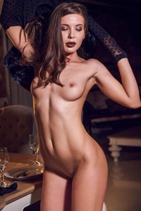Sweet angel Lika Dolce poses naked with the candles showing us her flaming body