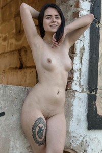 Irresistible dark haired girl Silver Leen poses naked in a ruined building