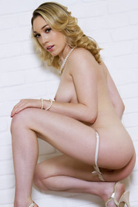 Smoking model Lily LaBeau shows her attractive young body in Milky Maiden