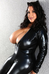 Chick in tight leather bodysuit pulls out her huge boobs to make your dreams much better
