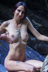 Skinny brunette Alisa M strips off presenting us her perky tits in this amazing posing performance
