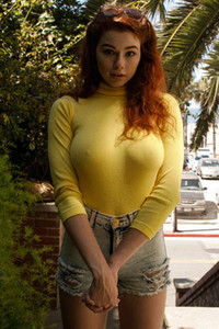 Beautiful ginger doll takes a walk and shows off her nipples over her yellow shirt