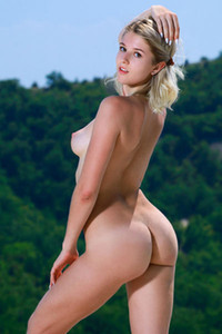 Lovely yet lonely blonde Libby is on her secret place in mountains enjoying the sunshine in nude