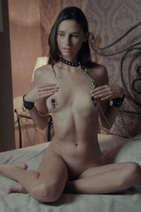 Sexy petite cutie in chains Cristin masturbates on the bed