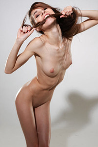 Lustful skinny chick Leona Mia shows off her gorgeous slim body