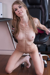 Foxy all natural vixen Eva Gold exposes her curves in her office