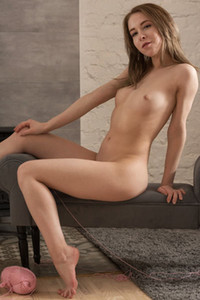 Good looking brunette already naked poses sensually giving us a nice view of her well shaped body