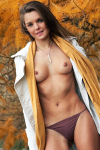 Skinny brunette Michelle Jean goes only topless giving us nice view on her natural boobs
