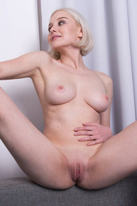 Kery is flirty blonde with amazing busty natural body that likes to pose naked