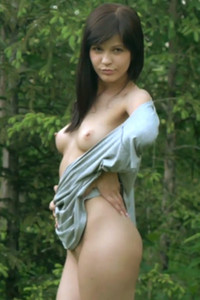 Playful brunette poses in nature presenting us her amazing body shapes and stunning posing skills