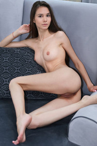 Fantastic Leona Mia is relaxing naked on sofa presenting us her tight pink pussy