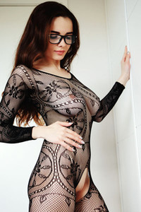 Hot brunette babe Maible poses in sexy crotchless lace bodysuit exposing her pussy