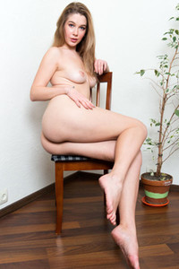 Adorable young brunette Genevieve Gandi spreads her legs showing you her tight pussy nicely