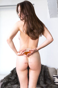 Beautiful brunette babe Tanya Grace drinks her wine and shows us her luscious ass and pussy