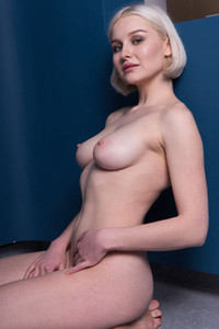 Platinum blonde vixen Natalie P strips her black top and jeans baring her big round boobs