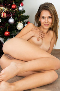 Amazing angel Laura Angelina erotically poses in Cumming For Christmas