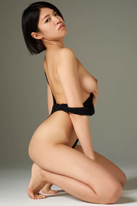 Sweet young Asian babe Sayoko slowly strips her black bodysuit and reveals her petite body