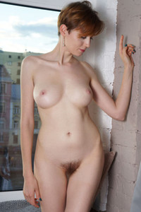 Short haired ginger gets fully naked presenting us her amazing skinny body in superb solo staff