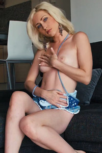 Seductive blue eyed vixen Janelle B twists her body and teases her love holes