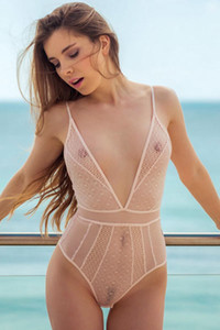 Perky titted brunette Kate Chromia is posing naked in transparent bodysuit looking so good