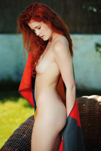 Luscious redhead doll Adel C twists her pale body to show us her sweet pussy and tits