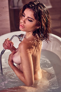 All natural brunette Chiara Arrighi is showing us her attributes while she is posing in bathtub