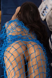 Exotic brunette honey plays with fishnet and shows us her yummy innie pussy