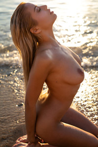 Fantastic hottie Margot exposing her busty body in shallow water