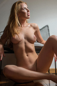 Astonishing blonde Helene already naked gives us a nice view on her big and beautiful breast