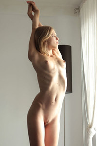 Slender and beautiful blonde goddess takes off her transparent bodysuit exposing her pale body