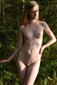 Babe with small boobs Malinka is in the woods is not shy to show us her dazzling pussy and tight ass